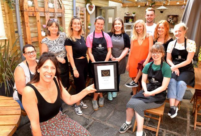 Nicola Jones and her staff at the Vinatge Birdcage Cakery in Yate with their Englands Business awards Best Cafe award.