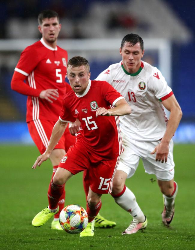 Wales' Joe Morrell and Belarus' Nikolai Signevich (right) battle for the ball during the International Friendly match at Cardiff City Stadium, Cardiff, Wales. PA Photo. Picture date: Monday September 9, 2019. See PA story SOCCER Wales. Photo credi