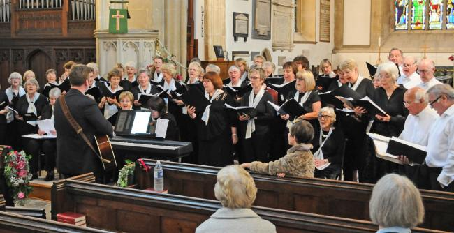 members of the Thornbury Good Afternoon Choirs with conductor Ben England at a recent concert