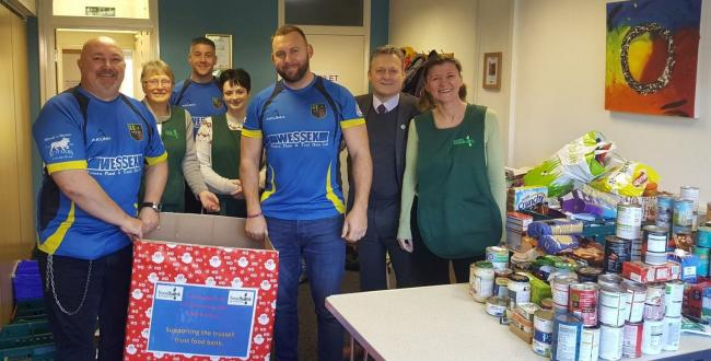 Mark Summerville, Neil Olive, Stewart Stacey and Martin Booth with some of the volunteers at the food bank