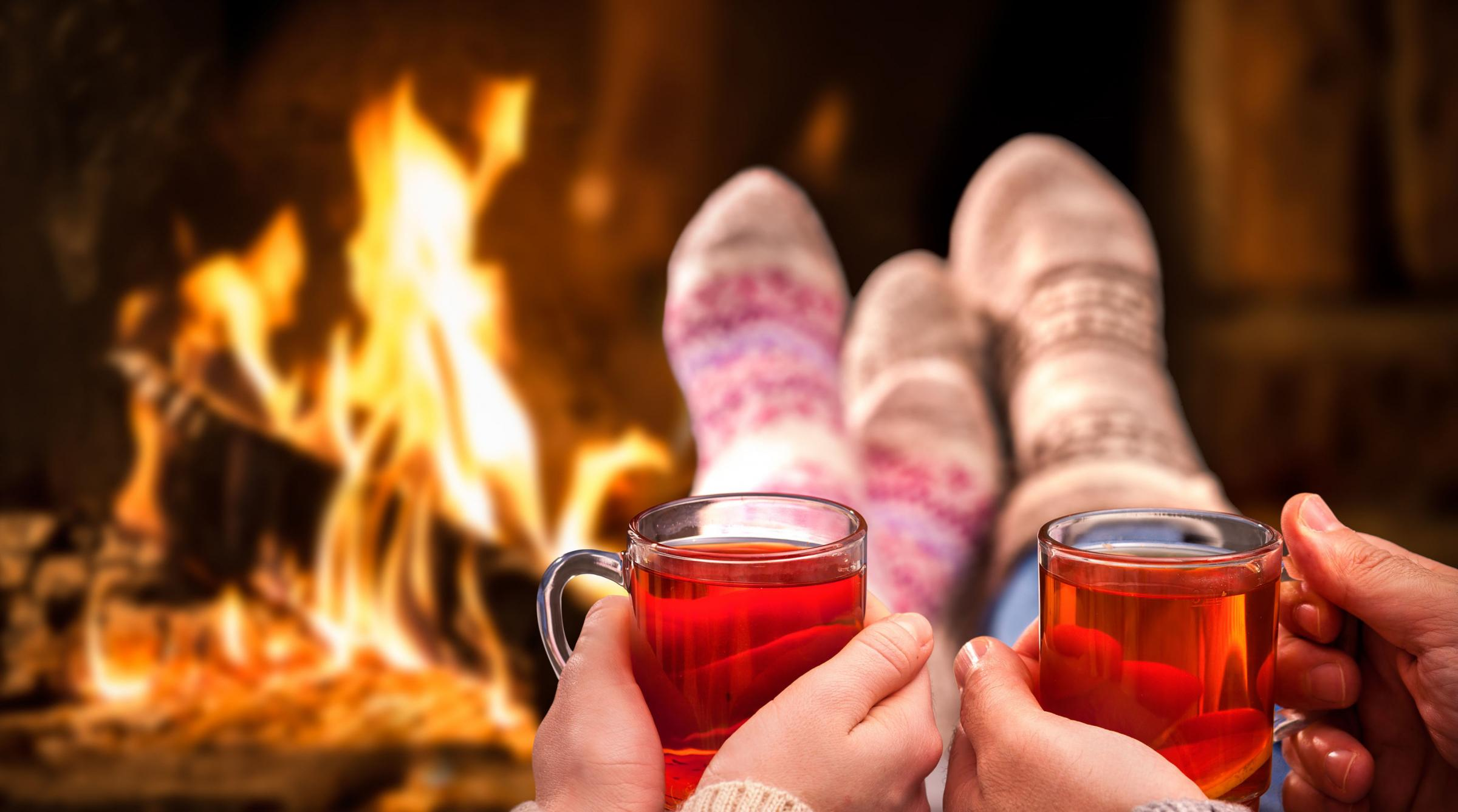 A generic photo of a couple curled up next to a roaring fire. See PA Feature HOMES Wood Fires. Picture credit should read: iStock/PA. WARNING: This picture must only be used to accompany PA Feature HOMES Wood Fires..