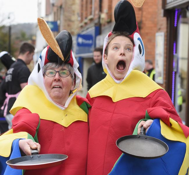 Viv Kennedy and Della Sykes, dressed as parrots. Photo from last year's race, taken by Simon Pizzey