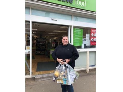 Volunteer Caroline Elliker, pictured with a delivery of pre ordered shopping from Berkeley Co-op. Orders can be made and paid for over the phone