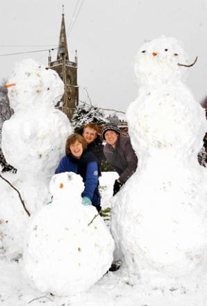 A family in Stone create a giant snowman family