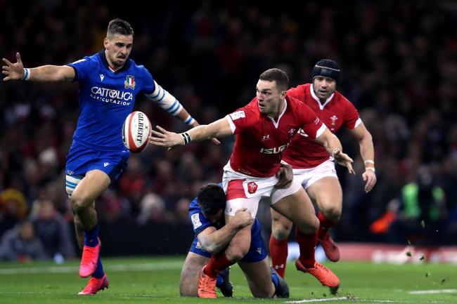 George North is tackled by Italy's Luca Morisi