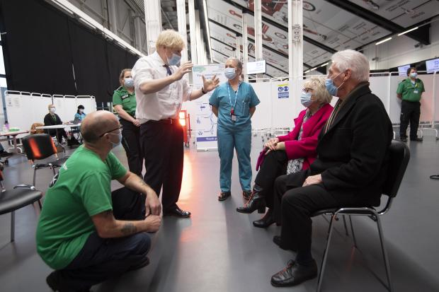 Gazette Series: Prime Minister Boris Johnson talks to Hazel and John Watson at Ashton Gate Stadium in Bristol during a visit to one of the seven mass vaccination centres now opened to the general public as the government continues to ramp up the vaccination programme aga