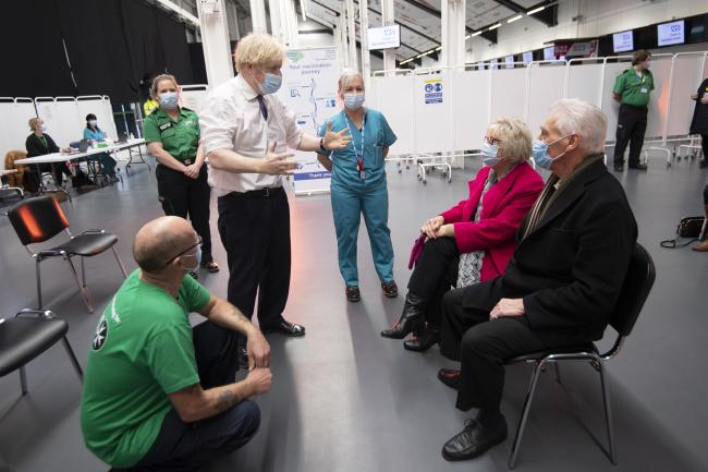 Prime Minister Boris Johnson talks to Hazel and John Watson at Ashton Gate Stadium in Bristol during a visit to one of the seven mass vaccination centres now opened to the general public as the government continues to ramp up the vaccination programme aga