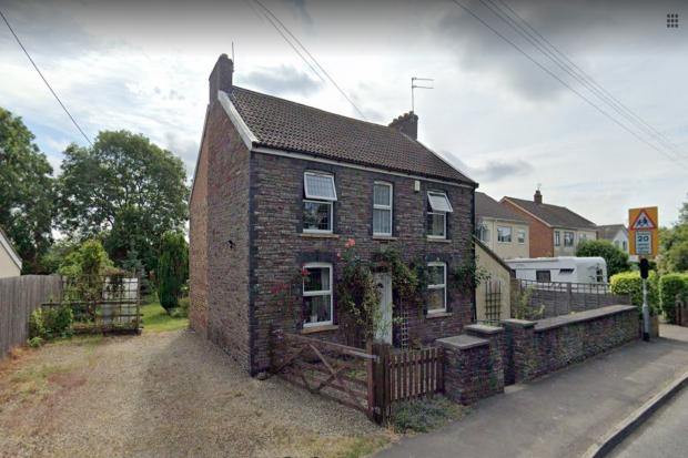 The stone cottage at 276 North Road in Engine Common which would be demolished under the plans for 89 homes (Image: Google, free to use by all partners)