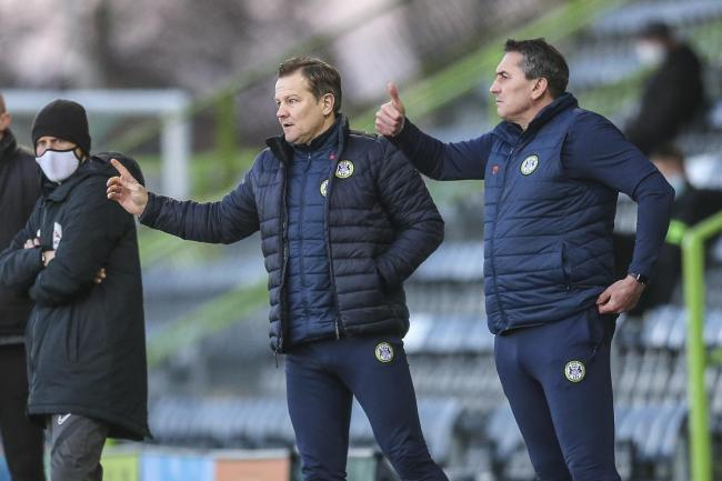 Forest Green Rovers head coach, Mark Cooper and Forest Green Rovers assistant manager Richard Dryden during the EFL Sky Bet League 2 match between Forest Green Rovers and Colchester United at the New Lawn, Forest Green, United Kingdom on 27 February 2021.