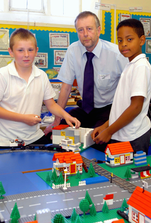 Philip Garside of Team Building Workshops with Tom Nourse, 10, and Adam Menzies, 10, of Horton Primary School during their town planning lego workshop