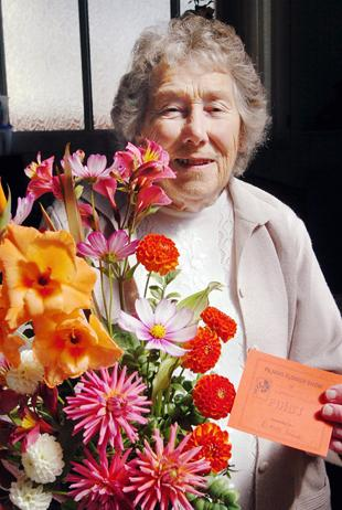 Elaine Hodge with her prize-winning garden flower arrangement at the Pilning Flower Show on Saturday