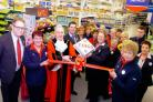 Mayor of Yate Cllr Ian Blair cuts the ribbon to the temporary Tesco store