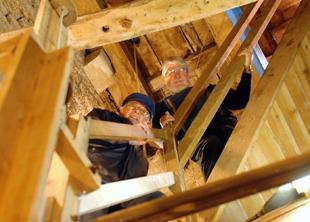 Roger Meredith and David Carrington on the stairway they repaired in the tower of St John's Church in Slimbridge
