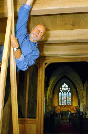 John Pinch under the new bell-ringing platform he built at St Cyr's Church in Stinchcombe
