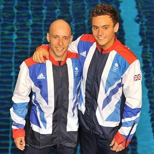 GB Olympic diving team members Pete Waterfield and Tom Daley finished fourth in the synchronised 10m platform final