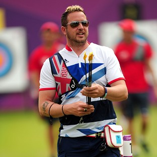 Larry Godfrey won his opening archery singles match for Team GB