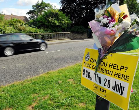 Flowers left by family members at the scene of the accident on Kennedy Way in Chipping Sodbury