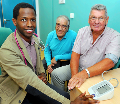 Dr Cyril Kamya with Tim Mills and Rae Care of the Frenchay Hospital Cardiac Support Group, who have donated £3,000 to the West Walk Surgery in Yate