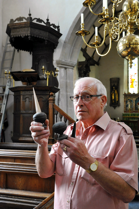 Mike Wheeler, church warden at St James the Less in Iron Acton, with a couple of the vandalised finials from the church pulpit