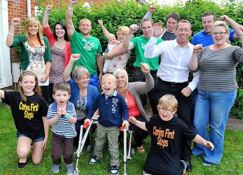 Corin Potts with his family and friends celebrate raising over £35,000