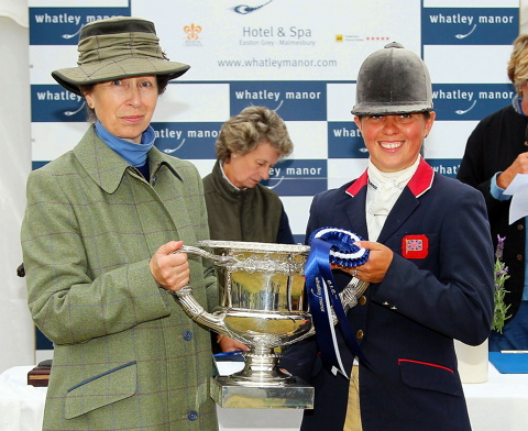 Kitty King receives her trophy from the Princess Royal at Gatcombe