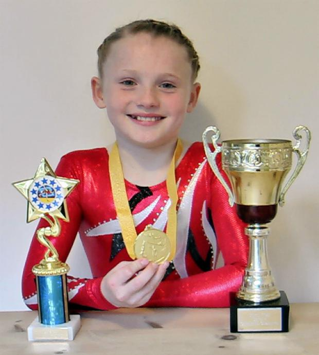 Oriel Powell with her trophies