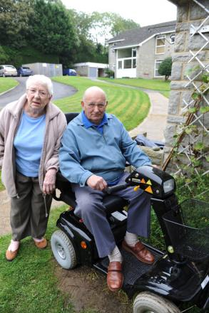 Les Allum and his wife Kathleen outside their home in Elm Lodge in Cam with their mobility scooter