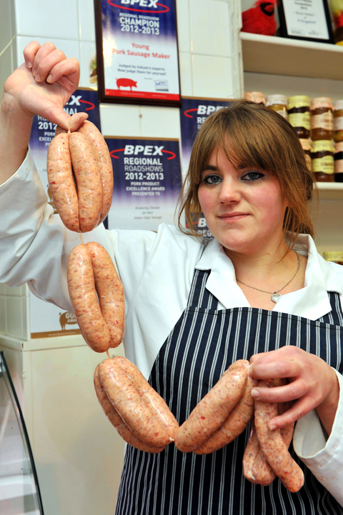 Kimberley Daniels of Artingstall's Butchers in Chipping Sodbury with some of her prize winning sausages