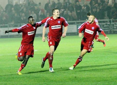 Yan Klukowski (centre) celebrates his second goal