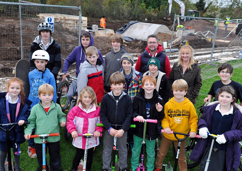Children from Hawkesbury Upton with some of the members of the skate park committee next to the new area on Hawkesbury Recreation Field