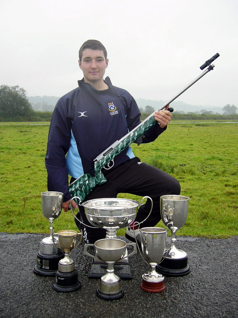 George Irish with his collection of trophies