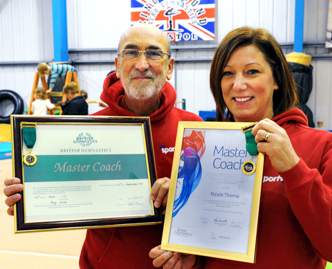 Tony Willis and Nikki Thorne with their Master Coach awards
