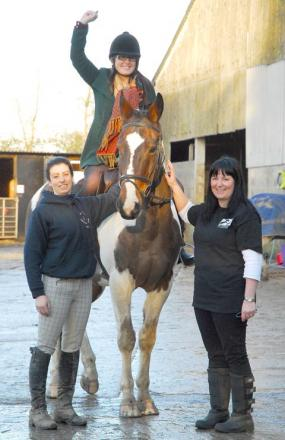 Tumpy Green Equestrian Centre owner Renee Watkins (left) and secretary of Friends of Tumpy Green Vikki Tatnell (right) who presented £1,000 to fundraising coordinator for the Great Western Air Ambulance Charity Emma Carter (on horse, Jack)