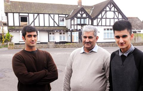 Akthar Shimam with his sons Ferhan and Fazan outside the Cross Hands in Pilning