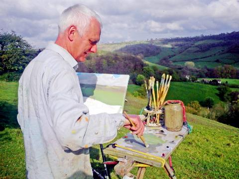 Renowned Wotton-under-Edge artist Rob Collins painting the view across Coombe in May 2012