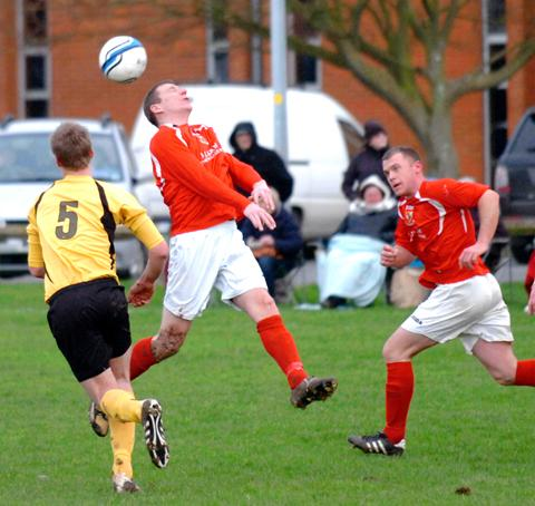 Matt Frankham goes for a header
