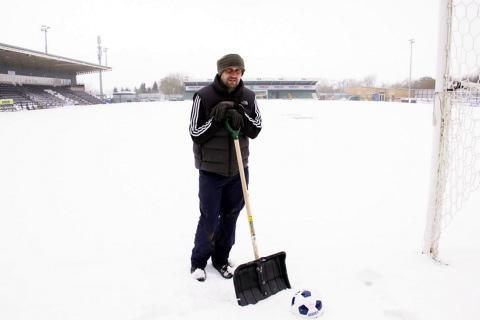 Forest Green groundsman Stewart Ward on the snowy New Lawn pitch