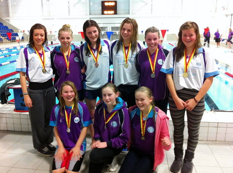 Girls from Severnside Tritons with their medals after the 1500m races in Gloucester