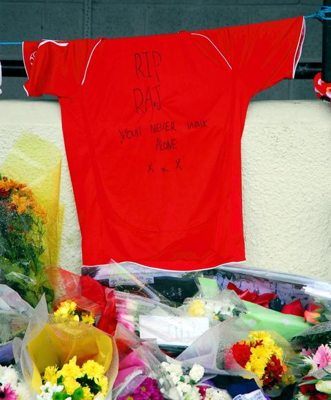 Flowers and a football shirt have been left for Mike 'Raj' Rodman at Kingswood AFC