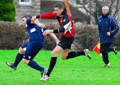 Cam's Sean Bailey in battle with Dursley goalscorer Aaron Nash GMW85H13