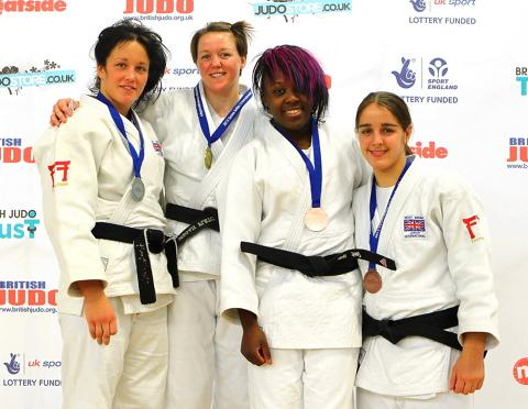 Megan Fletcher (second from left) with the gold medal she won at the 2013 British Judo Championships