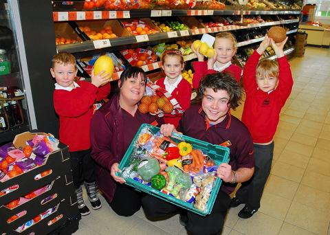 Sainsbury's staff with Dursley Primary School year two pupils (top left to right) Morgan Roberts, Maddie Arkwell, Izzy Clark and Ollie Pitt