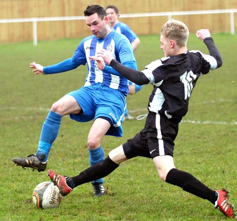 Frampton goalscorer Steve Jackson is tackled by Chipping Sodbury's Mitchell Price