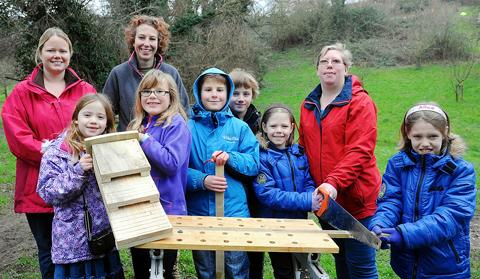 Children at the Bat Box workshop in Holywell Orchard, Cam
