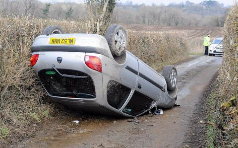 The driver of this Ford Fiesta was uninjured after rolling her car on ice in Fiery Lane, Uley