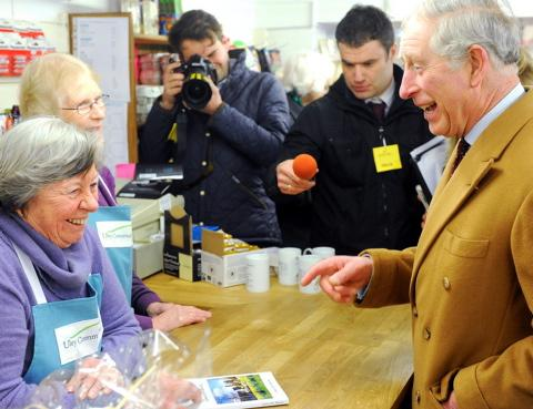 Prince Charles shares a joke with volunteer Christine Bebbington