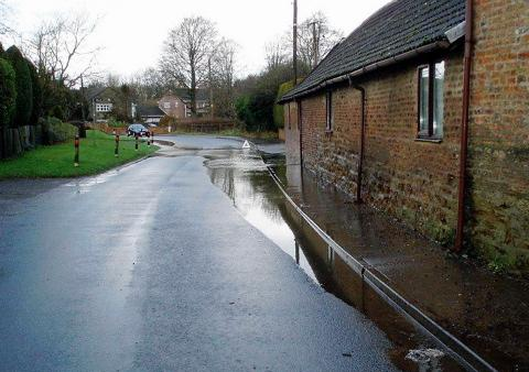 Sewage flooding on St John's Road which ends up splashed onto nearby homes