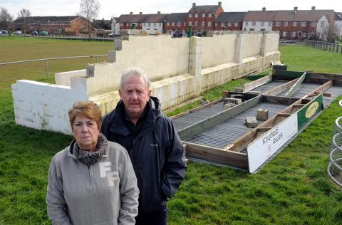 Diane and Tony Edwards next to the wind damaged Berkeley Football Club stand