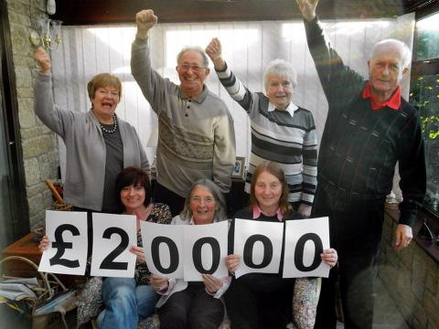 Acorns' Gloucestershire Support Group raising a cheer after hitting fundraising target