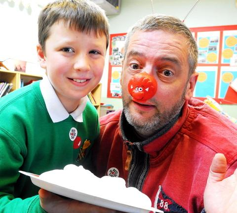 Yate's Ridge Junior School head teacher Philip Boult gets a custard pie in his face for Comic Relief